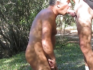 Daddy sucking grandpa's cock outdoors
