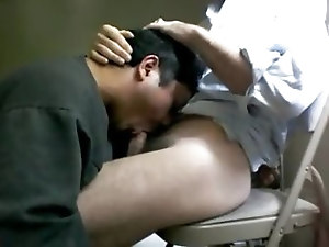 My middle aged gay Asian friend is engulfing my cock as I sit on a chair. He's on his knees, taking my dick deep in his throat as I fuck his mout